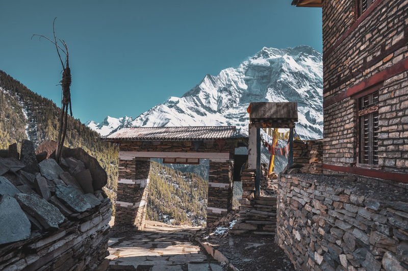 Nepal Travel Destinations Annapurna Conservation Area Travel Trekking Temple Religion Buddhism Village Rural Adventure Mountain Sky Architecture Built Structure My Best Travel Photo Historic Civilization A New Beginning