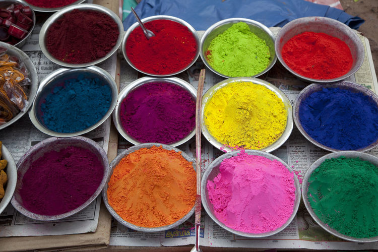 High angle view of colorful powder paints for sale at market
