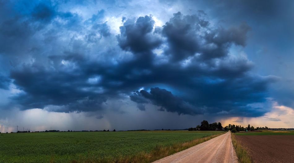 Panorama of storm cloud in Lithuania Cloud - Sky Sky Storm Environment Landscape Beauty In Nature Road Thunderstorm Storm Cloud Scenics - Nature Nature Field Direction Power In Nature No People Land Overcast Rural Scene Dramatic Sky Ominous Outdoors Extreme Weather Rain Climate Change Climate