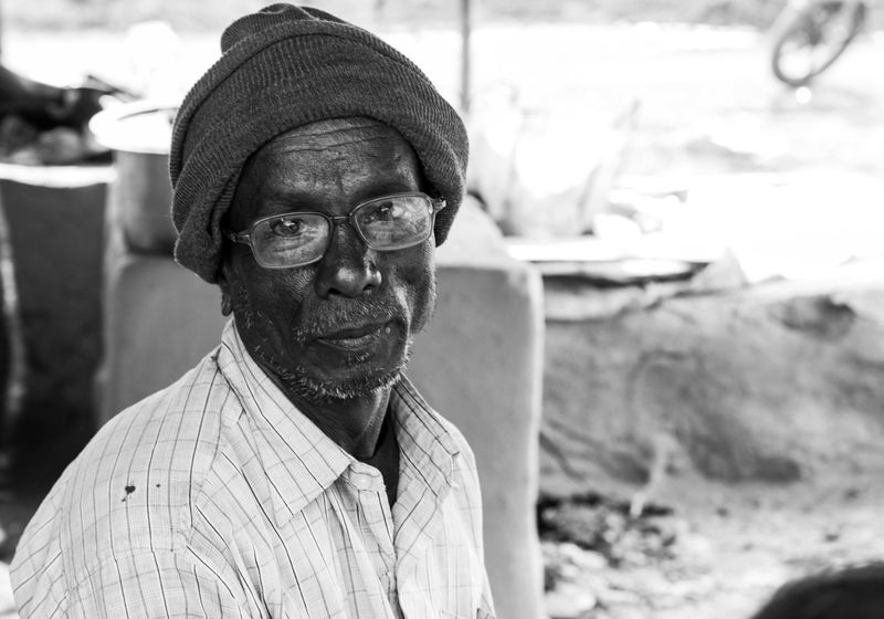 Old Man Poor Man Worker Wrinkle Cap Day Eyeglasses  Face Focus On Foreground Looking At Camera Monochrome Monochrome Photography One Person One Senior Man Only Outdoors Poor People  Portrait Real People Senior Adult Senior Men Smiling