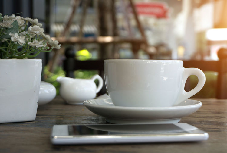 A cup of coffee on table Americano Capuccino Coffee Coffee Shop Coffee Time Latte Mocha Mocha Coffee Relaxing Sunlight Americano Coffee Art Cappuccino Capuchino Coffee Break Coffee Cup Cup Cup Of Coffee Drink Drink Coffee Latte Art Latteart Relaxation Relaxing Time Table