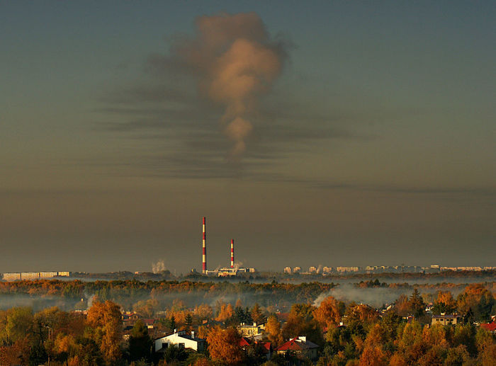 Distant Factory Against Sky In Poland