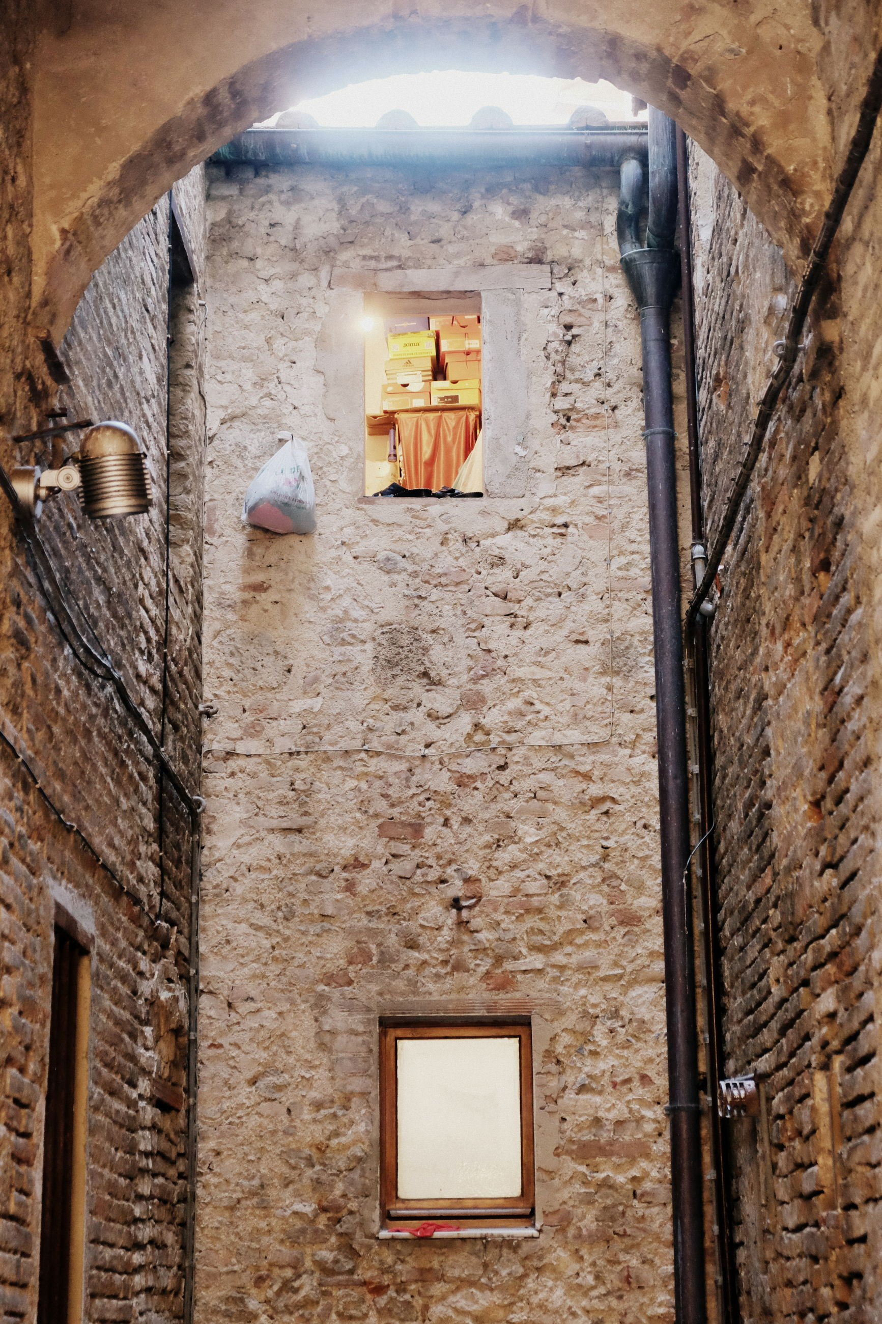 architecture, wall, built structure, no people, wall - building feature, building, low angle view, building exterior, brick, old, history, lighting equipment, the past, illuminated, window, brick wall, outdoors, house, day, electric lamp, ceiling