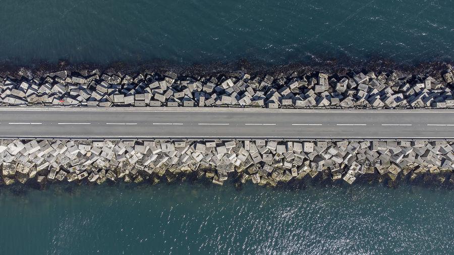 High angle view of lake by rocks