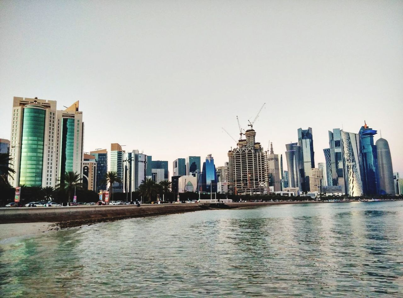 VIEW OF SKYSCRAPERS WITH WATERFRONT