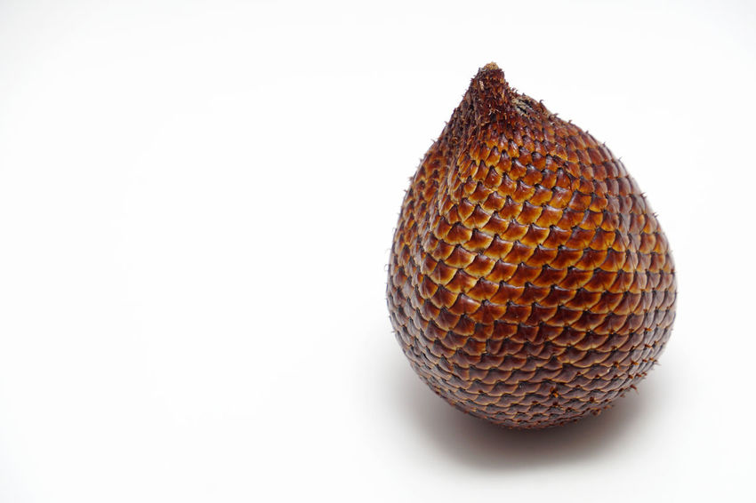 Tropical fruit, buah salak. Asian  Background Brown Color Delicious Exotic Food Fresh Fruit Health INDONESIA Isolated Local Malaysia Nature Organic Palm Pondoh Salacca Salak Snake Sweet Tasty Tropical White