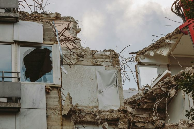 Low angle view of damaged house