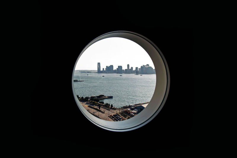 A cityscape from a circle window Architecture Circle City Cityscape Hudson River Interiors New Jersey Skyline View Circular Window Design Outdoors River Scenics Urban Window EyeEmNewHere The Week On EyeEm The Traveler - 2018 EyeEm Awards