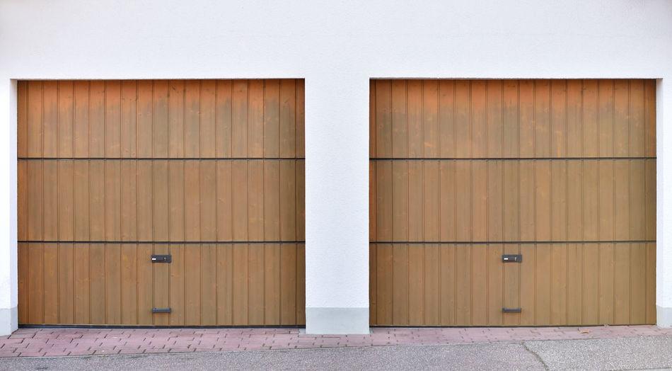 Two brown garage roller doors