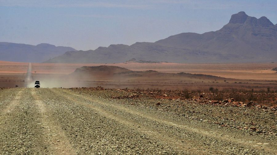 Desert Deserts Around The World Namibia Namibia Landscape NamibiaPhotography Arid Climate Beauty In Nature Desert Beauty Landscape Mountain Mountain Range Namibia Desert Nature Outdoors Road Rural Scene Scenics Tranquil Scene Tranquility Transportation