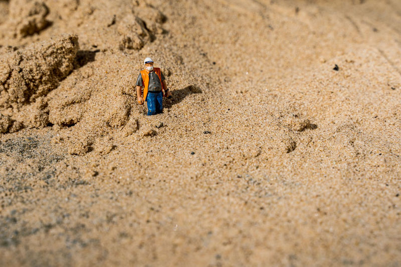 High angle view of small toy on beach