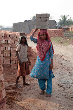 Technology Brick Carry Economy Field Girl India Industry Looking At Camera Manufacturing Primitive Rural Sarberia Village West Bengal Worker Young Women