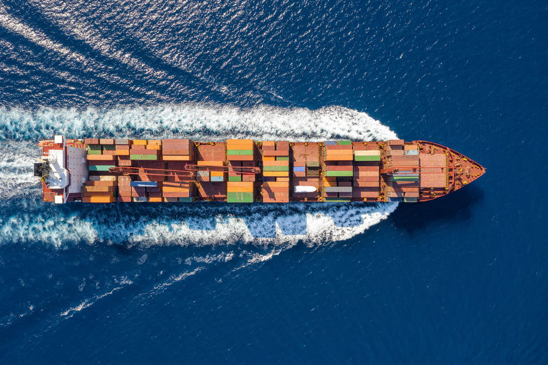 Directly above shot of container ship sailing in sea