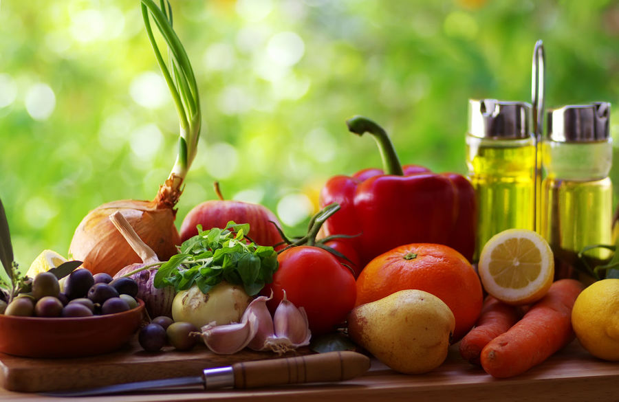 Ingredients for a mediterranean diet on green background close-up Container Food Food And Drink Freshness Fruit Healthy Eating Herb Mediterranean Diet Olive Oil Olives Onion Pepper Red Table Tomato Vegetable Wellbeing