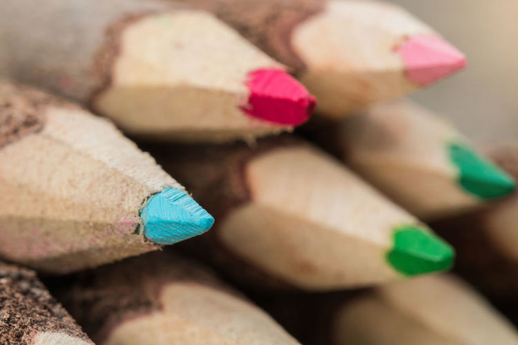 Extreme close-up Stack of wooden tree branch colorful pencils. Children Colored Pencil Objects Office Pencils Stack Tree Wood Child Close-up Color Colorful Drawing Education Equipment Large Group Of Objects Multi Colored Pencil Pencil Drawing Pencilart Pile Stick Table Variation Wood - Material