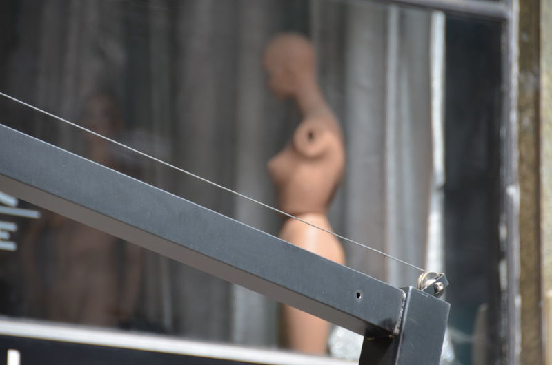Close-up of metal against mannequin in store