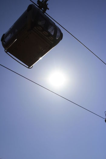 Silhouette overhead cable car with blue sky background in Korea Cable Low Angle View Sky Sunlight Nature Electricity  No People Sun Blue Clear Sky Day Power Line  Sunny Sunbeam Lighting Equipment Outdoors Light Lens Flare Connection Power Supply Bright Directly Below Silhouette