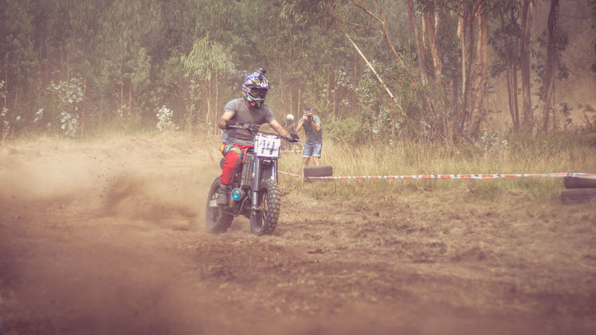 Adult Bicycle Cheerful Competition Cycling Day Dusty Track Grass Horizontal Men Motion Moto Motocross Motorcycle Motorcycles Nasmgraphia Outdoors People Person Real People Riding Speed Sports Race Tree Two People