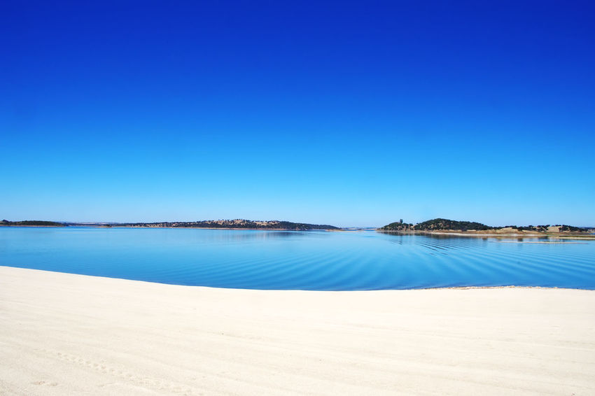 alqueva lake near Mourao village, south of Portugal South Of Portugal Alqueva Lake Beach Blue Nature No People Outdoors Sand Scenics Sky Tranquil Scene Tranquility Travel Destinations Water