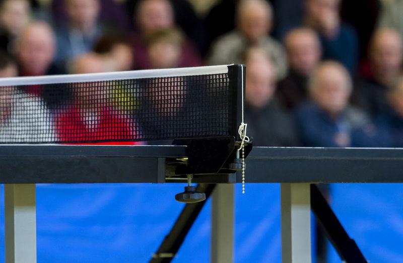 Table tennis net against spectators