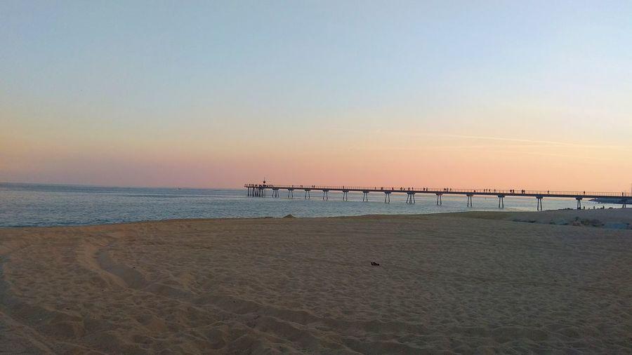 Pont Del Petroli, Badalona, Spain Beach Sea Horizon Over Water Sunset Sky Sand Outdoors Nature Water No People Beauty In Nature Day Catalonia Catalunya Badalona Catalunyaexperience