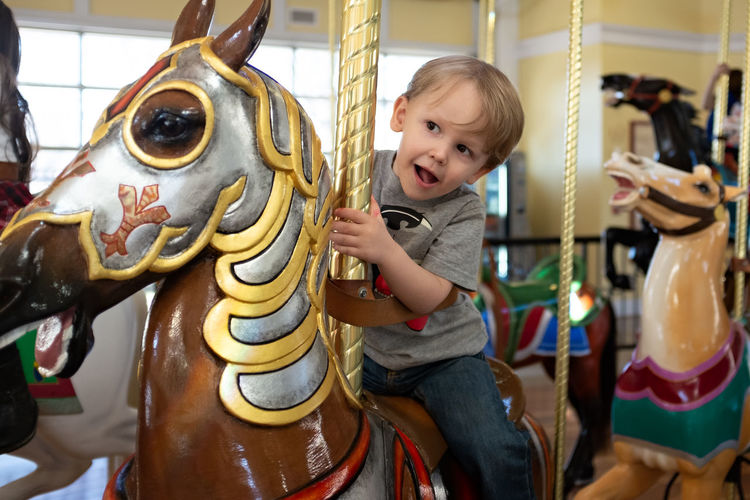 Boy toddler on a carousel horse First Eyeem Photo Babyhood Toddler  Amusement Park Ride Carnival Spinning Carnival - Celebration Event Carousel Horses Merry-go-round Traveling Carnival Amusement Park Ride Close-up Horse Childhood Carousel One Person Child Boys Innocence Real People Arts Culture And Entertainment Cute Casual Clothing
