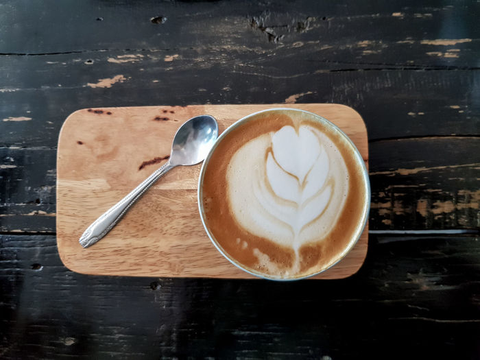 Coffee cup of cappuccino on wooden table