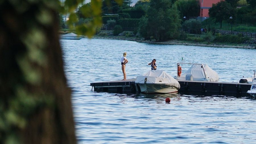 People fishing in lake
