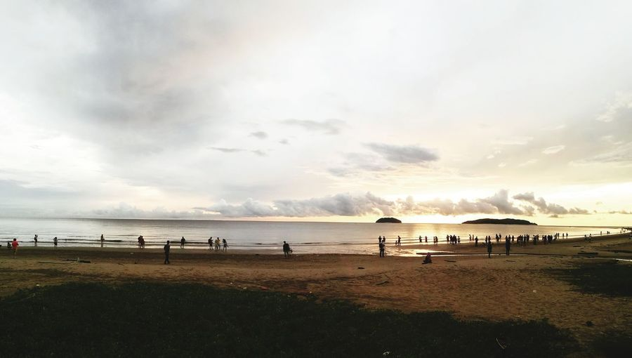 Sabah Malaysia Beach Sand Sea Full Length Vacations Cloud - Sky Landscape Silhouette Water Sky Horizon Over Water Grass Sunset Summer Outdoors Travel Destinations Camping Nature Sun People