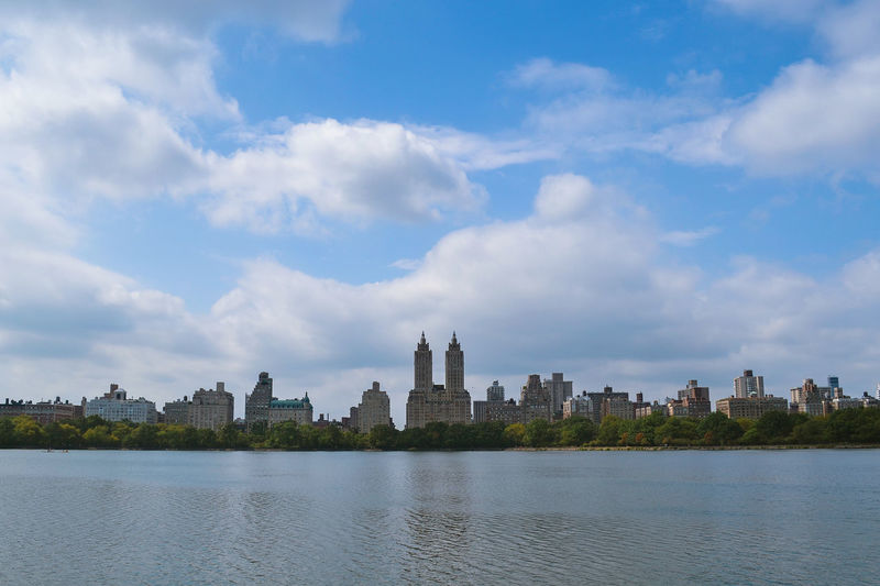 Architecture Blue Building Building Exterior Built Structure Central Park City Cityscape Cloud Cloud - Sky Clouds And Sky Day New York New York City No People Outdoors River Sky Sky And Clouds Tall - High Travel Destinations Water Waterfront