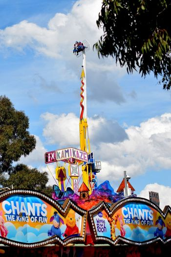 Amusement Parks Amusement Ride Cloud - Sky Low Angle View Multi Colored Outdoors Sign Tree