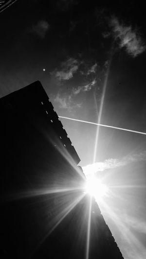 Illuminated Sunbeam Sky No People Black & White Darkness And Light Architecture Photography Urban Exploration Urban Geometry Urbanphotography Architecture_bw Architecture_collection Industrial Industrial Landscapes Pallets Darkness Darkside