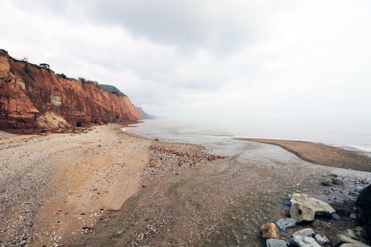 Sidmouth cliffs and beach. Cliffs Devon Sidmouth Beach Beauty In Nature Cliff Cloud - Sky Day Environment Formation Land Nature No People Non-urban Scene Outdoors Rock Rock - Object Scenics - Nature Sea Sky Solid Tranquil Scene Tranquility Uk Water