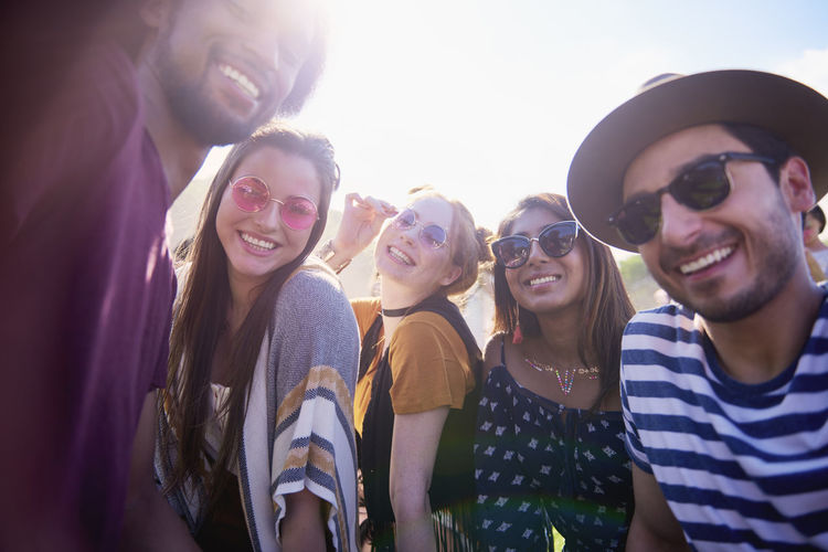 Happy Asian woman and her friends at the music festival Selfie Friends Festival Music Festival Traditional Festival Smiling Toothy Smile Photography Multi Ethnic Group Young Adult Group Of People People Outdoors Memories Summer Party Music Boho Adult Asian  Indian African Youth Culture Women Men Photography Themes Portrait Happiness Traveling Carnival Entertainment Photo Messaging Popular Music Concert Festival Goer Freedom Joy Live Event Embrace Sunglasses Fashion Fashionable Sunlight Sunny Positive Emotion Look At Camera