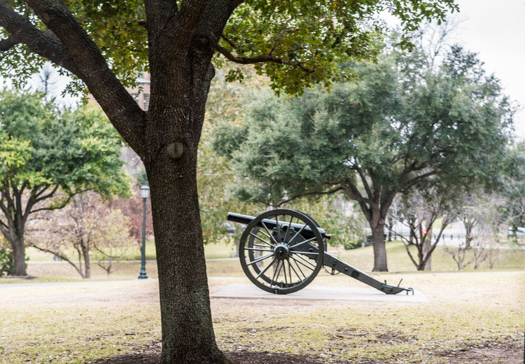 A historical cannon on display on the Texas State Capitol grounds. Austin, TX Texas Texas State Capitol Cannon Canon Fighting Historical History Howitzer Military No People Old Outdoors Weapon Wheel