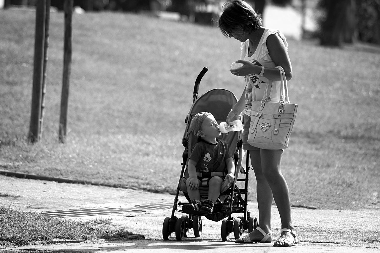 childhood, real people, full length, baby stroller, day, outdoors, boys, lifestyles, sunlight, two people, togetherness, child, people, adult