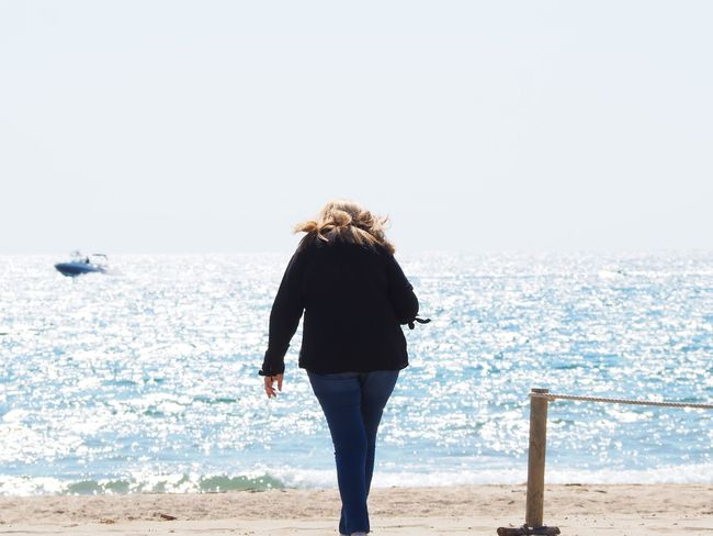 Travel Destinations Summer Exploratorium Costa Brava, Coast Costa Brava Mediterranean  EyeEm Selects Sea One Person Rear View Real People Sky Water Lifestyles Leisure Activity Beauty In Nature Beach Nature Full Length Day Clear Sky Women Scenics - Nature Horizon Over Water
