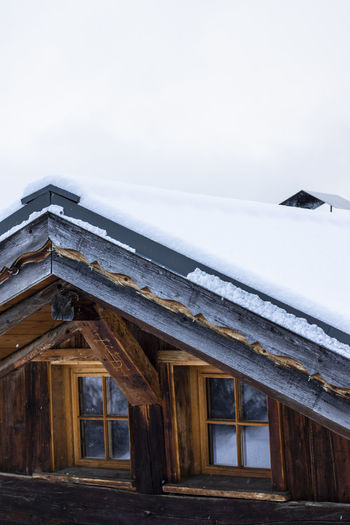 Low angle view of house against sky during winter
