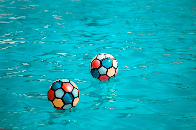 High angle view of balls in swimming pool