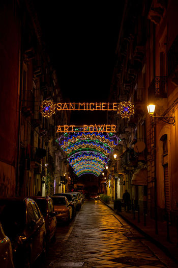 Italy Sicily Illuminated Architecture Night Lighting Equipment The Way Forward Decoration Direction Diminishing Perspective Built Structure Building Building Exterior No People Hanging In A Row Celebration Arch Religion Lantern Light Electric Lamp Alley
