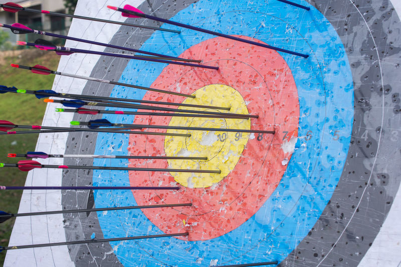 Archery target with arrows on it. Success concept Accuracy Achievement Archery Arrow - Bow And Arrow Art And Craft Blue Circle Close-up Concentric Day Leisure Activity Multi Colored No People Outdoors Pattern Recreational Pursuit Shape Skill  Sport Sports Target Target Shooting