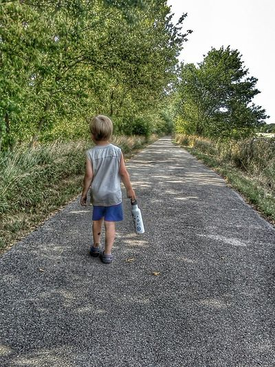 Boy walking on path Connected With Nature Nature Walk Color My Kid Editorial  Colorful Colors Color Photography Kid Boy Children Childhood Memories Kids Playing Kids Having Fun Kids Being Kids People Childhood Nature Path Outdoors Out For A Walk Memories Walk Walking Walking Alone... Path