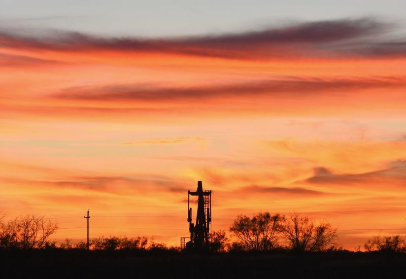 Sunset Sky Silhouette No People Nature Tree Outdoors Day Pump Jack With Sun Setting Behind It Rural Scene Romantic Sky Texas Photographer Nikonphotography This Week On Eyeem Texas Sky Cloudscape West Texas Landscape Dramatic Sky Sunsetsaroundtheworld Oil Field Oil Pump Cloud - Sky Silhouette