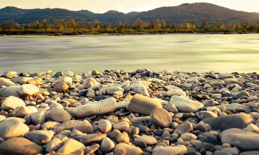 Rocks on shore by lake