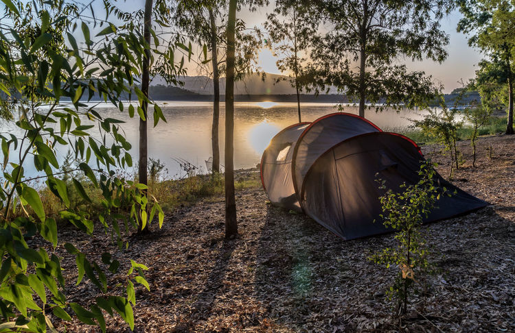 Camping Beauty In Nature Day Growth Lake Nature Outdoors Real People Scenics Sky Tent Tranquil Scene Tranquility Tree Water
