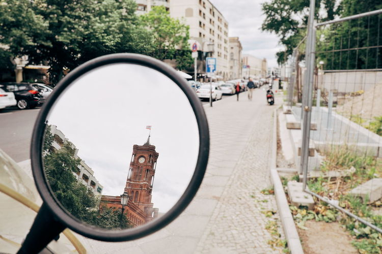 Reflection of street in side-view mirror