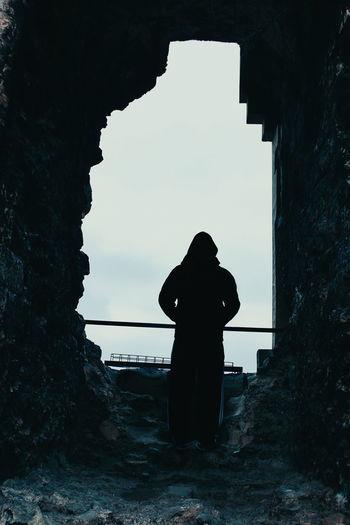 Silhouette woman sanding in old ruin