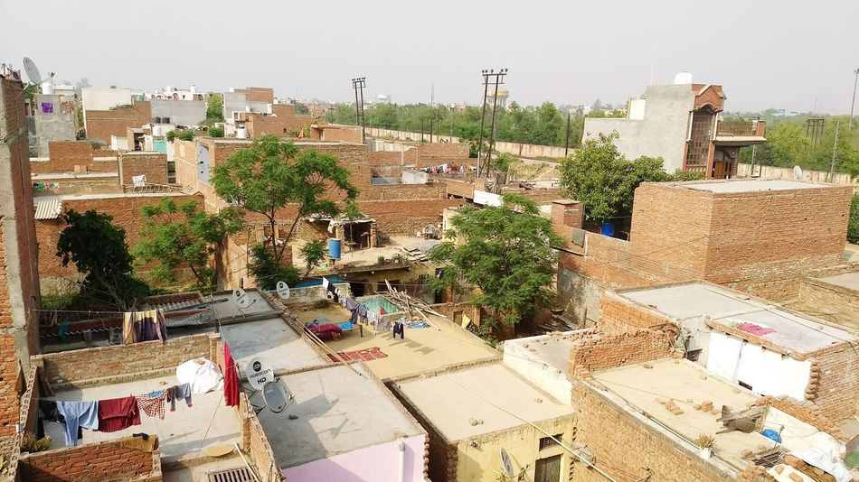 People Outdoors One PersonVillage Tree Men Day Village Photography Village House India Indianvillage Villagelife VillagescapeAdult Village Green City Only Men Adults Only Building Exterior One Man Only Architecture Cityscape Sky Urban Skyline Politics And Government