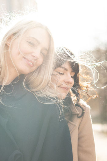 Windy and happy Blond Hair Front View Golden Hour Real People Portrait Smiling Face Contemplation Authentic Moments Authentic Long Hair Young Adult Beautiful Woman Casual Clothing Lifestyles Young Women Windy Hairstyle Outdoors Lens Flare Fashion Sunny Day Elégance Happy Women's Day Womanselfie International Women's Day 2019