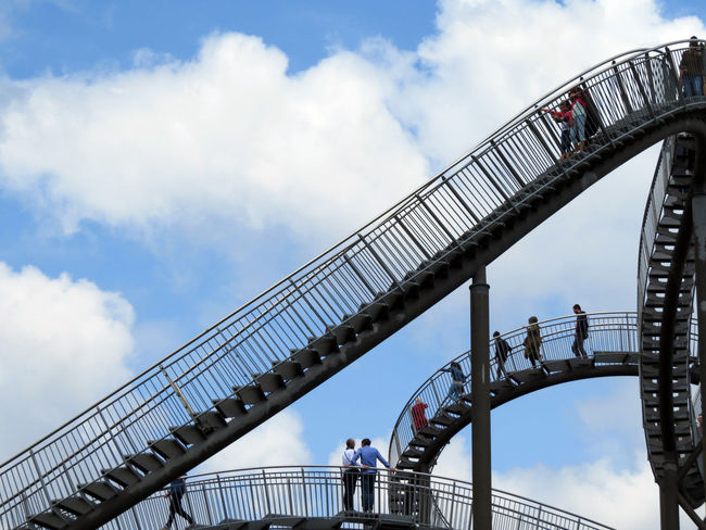 Duisburg Magic Mountain Rollercoaster Ruhrgebiet Ruhrpott Stairs Steps Tiger And Turtle – Magic Mountain Your Ticket To Europe Architecture Bridge - Man Made Structure Cloud - Sky Complexity Downstairs Outdoors Railing Real People Sky Staircase Stairways Steps And Staircases Tiger And Turtle Tourism Travel Destinations Walking